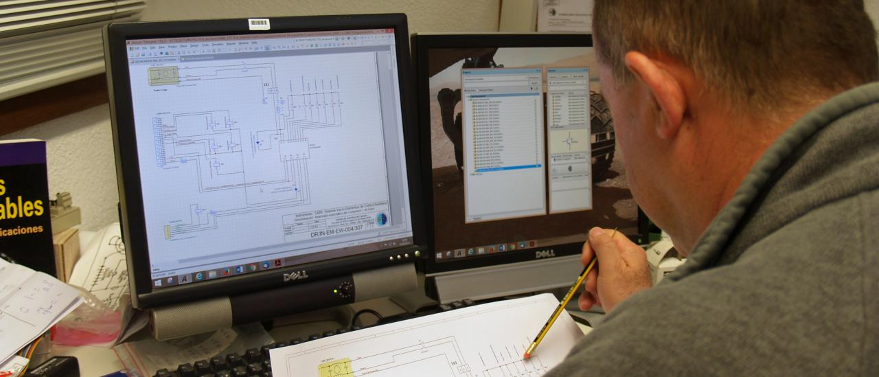 View of a technician working on an electronic design