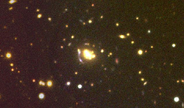 RGB image of PSZ1 G158.34-47.49, one of the clusters studied, which has a spectroscopic redshift z=0.311. In the image you can see a gravitational lens arc. The photometric image was taken with ACAM/WHT; the spectroscopic data are from DOLORES/TNG.