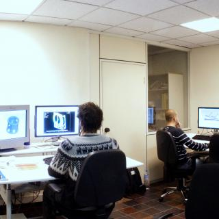 Panoramic view of the CAD studio with engineers working with desktop computers